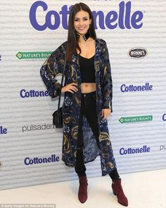 Gorgeous: Victoria Justice showed off her toned midriff in a black crop top with…