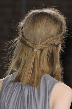 Relax—no one's asking you to do two fishtail braids by yourself. Two regular plaits joined in the back with a clear elastic wear just as well, especially after the heat unravels them a bit.   - MarieClaire.com