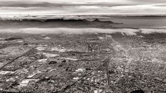 Aerial photography of the Cape Town with mountainous terrain soaring above the clouds in the background Aerial Photography, Amazing Photography, Mountainous Terrain, Above The Clouds, Urban Landscape, Landscape Photographers, Aerial View, Cape Town, Beautiful Landscapes