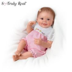 """Lifelike Interactive Baby Doll With Moving Feet,  mma Baby Doll   So Truly Real vinyl baby doll by Linda Murray delights with a FIRST-EVER interactive feature: touch her feet and they move. One-piece outfit included.    Measures 22"""" H"""