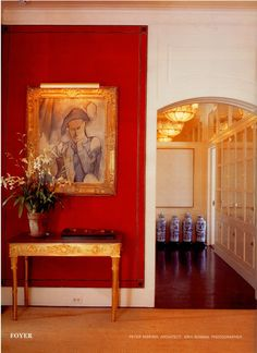 Marella Agnelli's 770 Park Avenue apartment.  A Picasso painting of a harlequin from 1909 over a Russian neoclassical ormolu and red quartzite table in the entrance hall.  Design by Renzo Mongiardino.  Photo by Eric Boman.