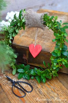 Christmas greens wreath with red heart