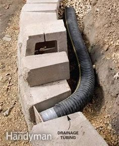 When building a retaining wall, lay perforated drainage tubing at the base of the wall slightly above ground level so runoff can drain out without undermining your wall