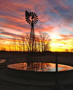 Windmill Sunrise Wish I had a camera, that is one pretty view. Oh that water looks inviting, but 2 more … Farm Windmill, Windmill Art, Old Windmills, Nature Landscape, Water Tower, Old Barns, Le Moulin, Ciel, Farm Life
