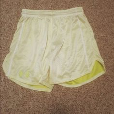 Under Armour Shorts Loose fitting mesh shorts. Super comfy, only worn a couple of times. White and highlighter yellow Under Armour Shorts