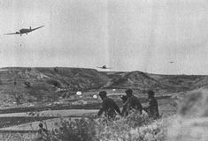 German paratroopers and Junkers transport aircraft flying over them in the area of height 107 in Crete, pin by Paolo Marzioli Paratrooper, Luftwaffe, Famous Photographers, Ww2, World War, Air Force, Aviation, Germany, Army