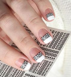 Black and white tribal inspired spring nail art. Make your French tips as interesting as ever with this tribal themed design in black and white nail polish.