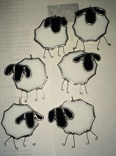 Herd of sheep. Stained glass ornaments.