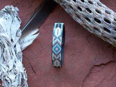 Feather and Diamond Native American Beaded Leather Bracelet with the blends of silvers, white and splash of blue turquoise by LJ Greywolf by LJGreywolf on Etsy https://www.etsy.com/listing/169602859/feather-and-diamond-native-american