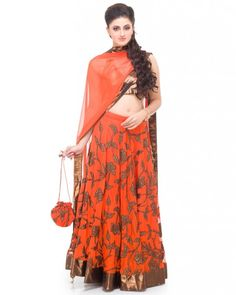 A stunning Orange & Copper Lehenga with a jaal of copper wotk on the skirt. The dupatta is in net with a border of copper lurex and embroidery on the edges. Style this with a matching potli and statement earrings to complete the look.#Ootd #Potd #Qotd #Fashion #Shopping #WomenWear #IndianWear #Style #Blogger #Mumbai #Wedding #OutfitOfTheDay