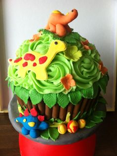 Giant Dinosaur cupcake!  http://Facebook.com/rachaelscupcakehouse