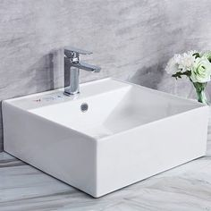 CB HOME Ceramic Square Vessel Bathroom Sink DESIGN: Sleek European inspired modern contemporary design MATERIAL: Ceramic. Ceramic for lasting beauty and exceptional durability FINISHED: Polished. Finest ceramic vessel with high chemical and thermal shock resistance DIMENSION: 18.25'' L x 18.25'' W x 6.25'' H Blending subtle design elements found in craftsman furniture with the intricate facets of jewelry, the CE collection achieves an interesting transitional aesthetic with a timeless appeal. Co Bathroom Sink Design, Drop In Bathroom Sinks, Undermount Bathroom Sink, Modern Bathroom Decor, Bathroom Styling, Master Bathroom, Bathroom Ideas, Bathrooms, Craftsman Furniture