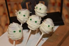 Halloween Party food and snacks: Mummies in a graveyard (red velvet cake filling is especially fitting)