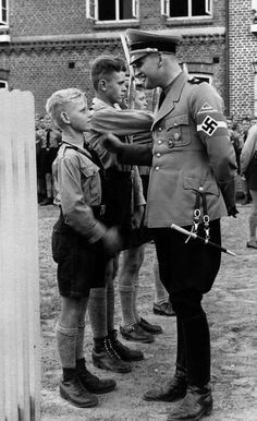 This sort of Nazi shit sickens me. While 1.5 million Jewish children were being murdered, this apology for a human being poses with brainwashed children, in their stinking Hitler Youth uniforms. This creature can't even smile - that's a grimace on its hideous face. What a mad world - thousands of criminals, strutting around murdering innocent people. Never forget? Anti-Semitism is at its worst now since 1945.