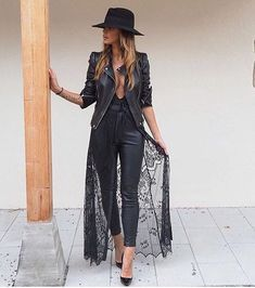 All black outfit with lace, leather, and a hat
