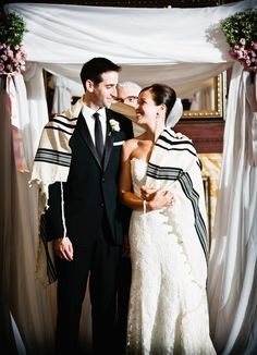 A traditional Jewish wedding ceremony with the bride and groom beaming!
