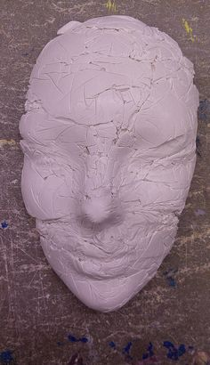 I'm molding faces in plaster at the moment. The most fun I've had in awhile. Clingfilm adds that interesting wrinkled/cracked effect.