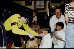 Michael with children.so sweet