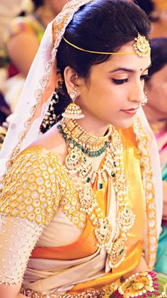 The Telugu Bride have in-numerable choices of wedding dresses, the most preferred is a saree again with many colour options to choose from. A telugu Bride wears a simple maang tika, a simple forehead chain, a nose stud or a simple nose ring, Necklaces large in size, Bell ear rings. Mehindi and parani is common as well. http://www.couponskingdom.in/2016/02/the-great-indian-marriages-wedding.html