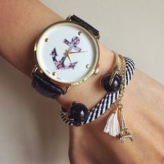 Image via We Heart It #anchor #bracelets #clock #eiffeltower #girly #style #time #watch