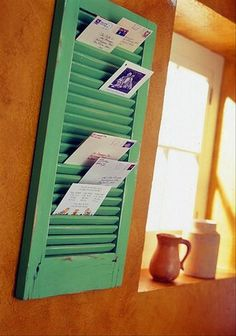 25 Genius Craft Ideas | Paint and hang a shutter to store mail. Aaaannnd this is my medicine cabinet.....time to repurpose that terrible decision!