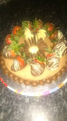 My attempt at a chocolate cake with chocolate covered strawberries and chocolate buttons 😊