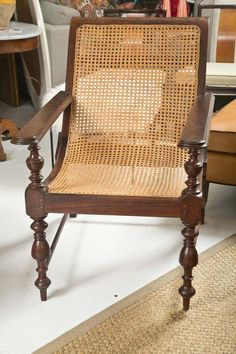 View this item and discover similar lounge chairs for sale at - Excellent condition British Colonial Plantation chair in Walnut stained Mahogany. Very well made with finely turned supports and legs. Purchased in India. Colonial Chair, Campaign Furniture, British Colonial Style, Walnut Stain, Take A Seat, Chairs For Sale, Rattan, Armchair