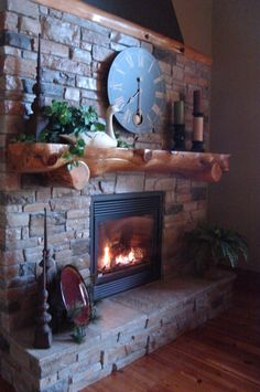 Stone fireplace, with a wooden mantle. #rustic #design #decor #interiordesign