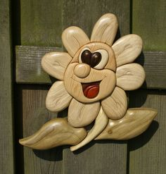 Happy Flower Made out of pine, hornbeam, black walnut, kotibe, redheart and green poplar (Intarsia Woodworking)