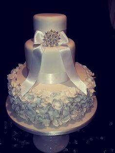White 3 tier ruffle with diamonte broach wedding cake