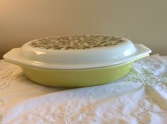 $19.99 plus shipping.   Vintage Verde Green Pyrex Divided Casserole Dish with Lid. Terrific vintage Pyrex divided casserole dish with verde green lid. Great mix of olive green and lemon lime colors. In great vintage condition with no chips or cracks. Can go straight from oven to table. Marked Pyrex on the bottom. Nice addition for Pyrex collectors and mod-retro lovers!