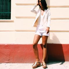 31 Perfect Looks To Copy This July #refinery29  http://www.refinery29.com/2016/07/115554/new-outfit-ideas-july-2016#slide-15  How to wear shorts to work: Pair with a bodysuit, blazer, and stylish flatforms....