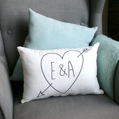 A throwback to school jotter sketches of everlasting love!Cushion available in white and includes plump hollowfibre inner.This cushion can be personalised as shown to include the initals of any happy couple encased in a sketched heart with cupids bow. The relaxed sketchy font is perfect for a young couple and would make an ideal valentines, engagenent, wedding or anniversary gift. This cute cushion will look great on any sofa or bed.Designed and printed in the UK. All cushions are made from…