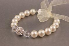 ERYN Bridal Jewelry Pearl Jewelry Wedding Bracelet - Swarovski Pearl Bracelet with Rhinestone Bead & Organza Ribbon from Camilla Christine. $58.00, via Etsy.