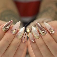 beautiful gold and nude acrylic nails with accents