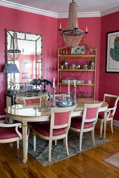 Corbin Lee Gurkin Dining Room: Second hand dining set with gold painted accents to add formality. Chairs recovered in a rose emu leather to match walls. Pink beaded chandelier. A daring choice, but it seems to work.