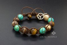 Hand crafted Shamballa Bracelet made of 10mm Natural Stone Beads and Swarovski Elements - Swarovski Crystal Pearls, Faceted Tigers Eye, Brown Retro Agate, Blue Turquoise, and Beige Mother of Pearl, combined with dark brown waxed shamballa cord. The item ends with two Faceted Brown Tigers