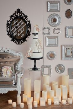 I would love to incorporate a frame with a love quote or use the frame to display signage of some sort. Also, LOVE all the candles.   From WedLuxe Magazine