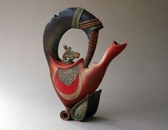 Hand-built Stoneware Sculptural Teapot 15 1/2 x 12 1/2 x 3 3/4    I did a series of teapots with plant shapes as the inspirational launching