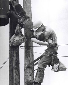 "historicaltimes: """"The Kiss of Life"": A utility worker, J.D. Thompson, giving mouth-to-mouth to co-worker Randall G. Champion after he contacted a high voltage wire -Full details in comments- cobb__salad: """" This photo shows two power linemen,..."