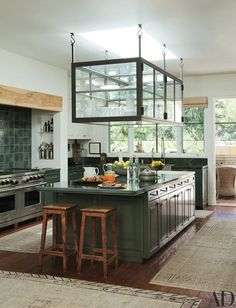 green kitchen island with green tile backsplash