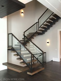 ] Contemporary Stair Railing Regarding Monostringer With Boxed White Oak Treads Iron Wire Stairs Railings Modern Railings Custom Stairs Chicago Modern 88 Contemporary Stair Railing Tamara Castonguay Staircase More click [. Interior Stair Railing, Modern Stair Railing, Stair Railing Design, Staircase Railings, Modern Stairs, Railing Ideas, Staircase Ideas, Glass Stair Railing, Wood Stairs