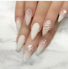 False nails have the advantage of offering a manicure worthy of the most advanced backstage and to hold longer than a simple nail polish. The problem is how to remove them without damaging your nails. Marriage is one of the… Continue Reading → Stiletto Nail Art, Gel Nail Art, Gel Nails, Acrylic Nails, Coffin Nails, Nail Nail, Unicorn Nails Designs, Unicorn Nail Art, Bridal Nails