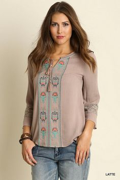 Latte colored peasant style top with colorful embroidery on the front and lace insets in the sleeves. This is hands down a staff favorite! Fit Tip: Fits true Ma
