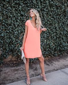 Our Zoey Shift Dress is adorable in this classic shift silhouette. This eye catching piece is as energetic and lively as it looks in this vibrant hue! The cap sleeves, v-neckline and easy fit make thi