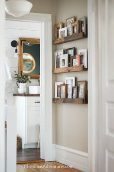 Easy DIY picture ledge - a great way to decorate a narrow hallway. This is a flexible alternative to a gallery wall!