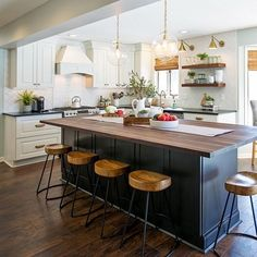 the look of @nadeaucreativemn's new favorite family gathering spot remodeled by @finitodesignco. Kitchen island is#CliqStudios shaker-style Rockford cabinets in Painted Carbon finish and raised-panel Mendota cabinets in Painted White around the perimeter.