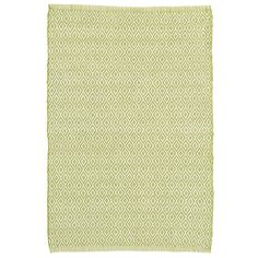 Put a little spring in your step with this durable, eco-friendly indoor/outdoor rug in a classic diamond pattern and fresh green hue. Mix and match with our  Stone Soup  and  Fisher Ticking indoor/outdoor rugs.