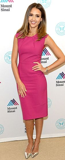 Jessica Alba looked pretty in pink in this modest day dress. She completed the look with a pair of polished metallic pumps.