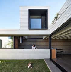 This is a rear extension to a single-storey cottage in Brunswick designed by MAKE Architecture. The new addition pulls living areas to the . Australian Interior Design, Interior Design Awards, Sun Projects, Cottage Extension, Concrete Block Walls, Sun House, Rear Extension, Roof Structure, Roof Light